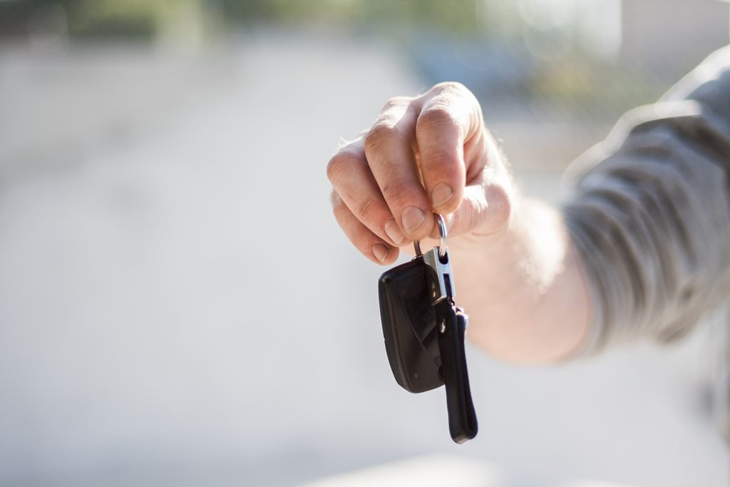 Man giving car rental keys