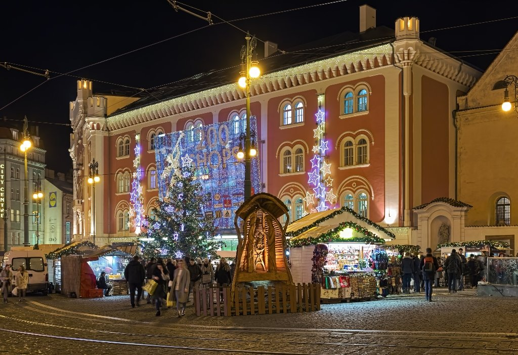Christmas market stalls and a Christmas tree with fairylights in front of the Namesti Republiky Palladium Shopping Center in Prague Czech Republic