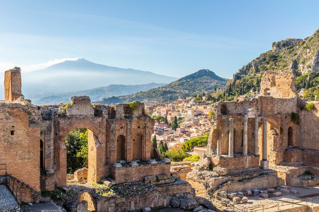 The stage of Taormina's Greek Theater with Mount Etna in the background, Taormina, Sicily