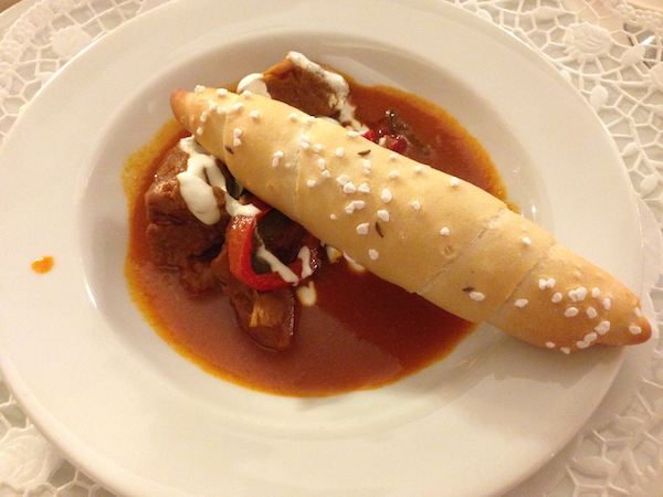 Veal Goulash with a Salzstangerl (Salted Roll) - Photo Credit To Elena Paschinger from Creative Elena | http://www.creativelena.com/en/travel-blog/schickhotels-means-exploring-vienna-in-style-top-comfort-culinary-travel-tips-for-you-here/